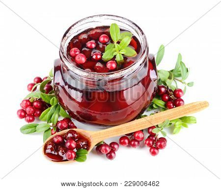 Jar With Cowberry Jelly, Wooden Spoon And Fresh Berrys On White Background