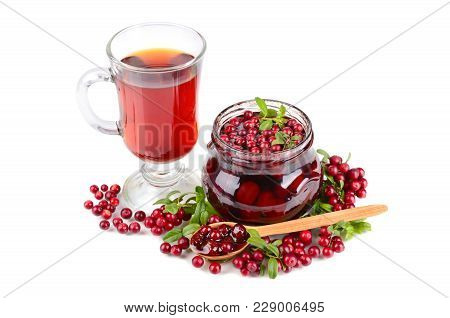 Tea In Glass Cup, Cowberry Sweet Jam, Wooden Spoon And Fresh Berrys On White Background