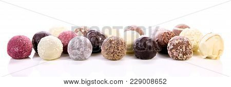 Variation Of Different Chocolate Truffles Or Pralines, White Background