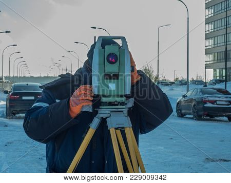 Engineer Works With The Theodolite Close Up