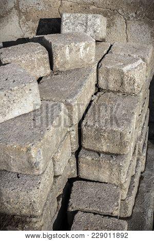 Pile Of Old Pavement Bricks, Concrete Blocks For Paving. Pavement Bricks Are Stacking For Rearrangem