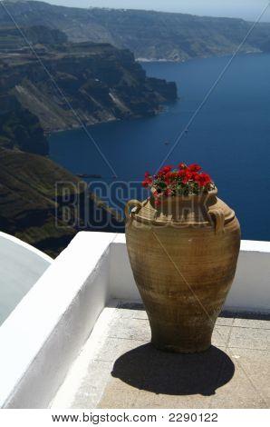 A Greek Vase On A Porch Of A Sanorini'S House Above The Caldera