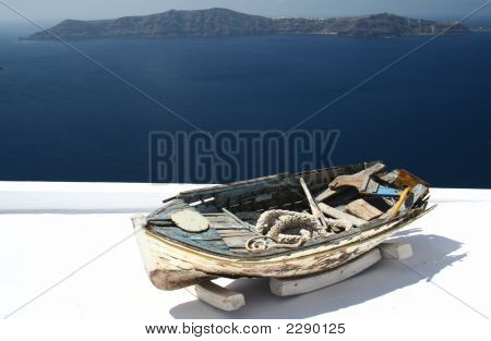 Of An Old Boat On The Roof Of A Santorini'S House Above The Thera'S Caldera