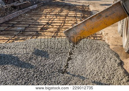 Pouring Ready-mixed Concrete After Placing Steel Reinforcement To Make The Road By Mixing Mobile The