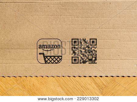 Paris, France - Feb 21, 2018: Amazon Prime Box Detail With Qr Code For The Mobile App On  Wooden Bac