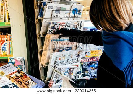 Paris, France - Jan  21, 2017: Woman Buying At Media Press Kiosk The Financial Times Weekend Edition