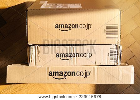 Paris, France - Feb 21, 2018: View From Above Of Multiple Amazon Prime Japan Boxes Stack On Wooden B