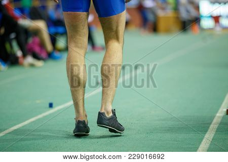 Sportsman Getting Ready In Long Jump Competition. Track And Field Competitions Concept Background