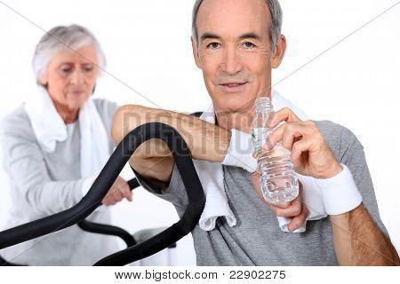 elderly people doing indoor sport