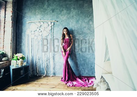 Beautiful Stylish Fashion Model Woman In Lilac Dress Posing In Boho Chic Style Interior
