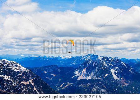 Paraglider In The Dachstein Alps Mountains In Salzkammergut Region, Austria View From Five Fingers V
