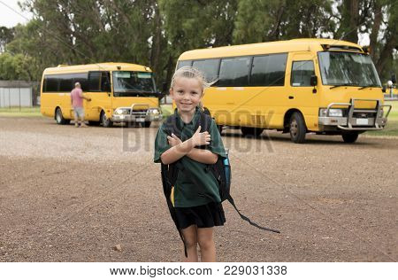 Lovely And Beautiful Blond Caucasian Female Child Waiting For School Bus Carrying Backpack Smiling H