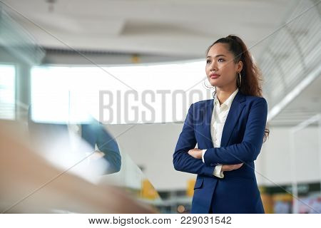 Confident Ambitious Vietnamese Business Lady Standing With Her Arms Crossed