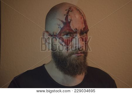 Orange Make Up With The Guy. Scary Portrait Of A Guy. Make Up The Skull. A Man With A Terrible Fake.