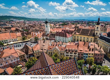 Sibiu, Romania - July 7, 2016: Holy Trinity Church And Council Tower In Sibiu City, View From The Be