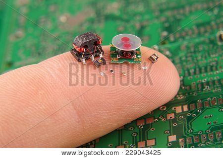 Modern Electronics Surface Mount Components In Comparison To Human Finger