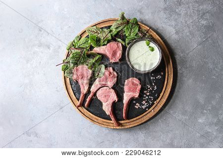 Grilled Sliced Rack Of Lamb With Yogurt Mint Sauce Served With Green Salad Young Beetroot Leaves And