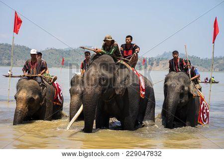 Dak Lak , Vietnam - March 12, 2017 : Elephant Racing In Water Festival By Lak Lake In Dak Lak, Cente