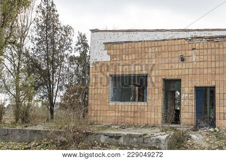 Abandoned Building. Ruins Of The River Port In One Of The Cities In Eastern Europe. Facade Of An Aba