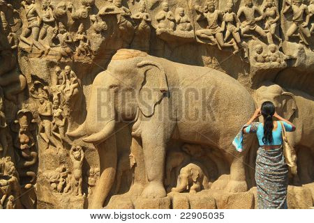 Woman Photographing Ancient Carvings