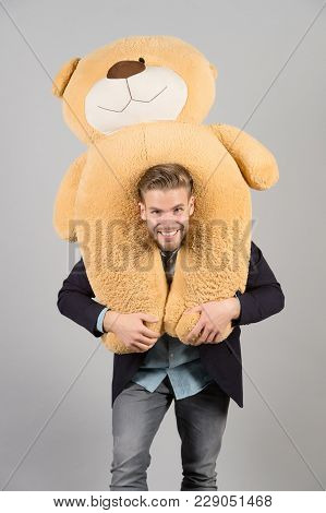 Macho Smiling With Big Animal Toy, Present. Happy Man With Brown Teddy Bear, Gift. Gift, Present Con