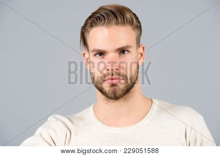 Macho In Tshirt On Grey Background, Fashion. Man With Bearded Face, Stylish Hair, Haircut, Salon. Fa