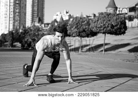 Ready Steady Go. Healthy Lifestyle Concept. Man Runner At Starting Position. Athlete On Asphalt Path