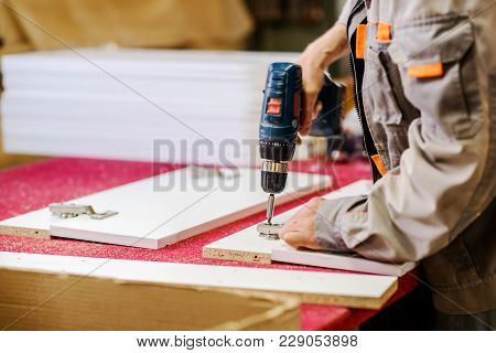 Closeup Of A Carpenter Working In His Workshop