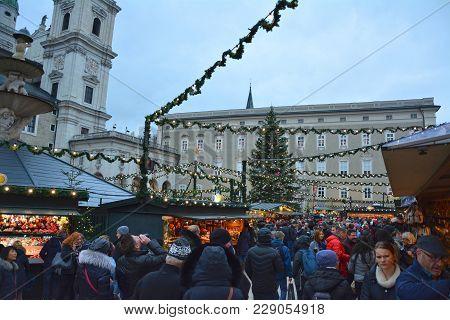 Salzburg, Austria - November 25, 2017 : People Enjoy Traditional Christmas Market On Mozartplatz In