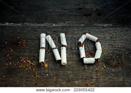 No Smoking. Stop Smoking. The Broken Cigarettes On A Wooden Background