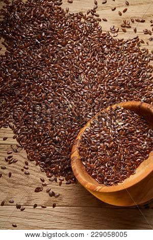 An Overturned Wooden Bowl With Linseeds On A Rustic Background, Close-up, Shallow Depth Of Field, Se