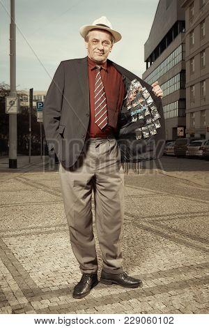 Older Dealer Of Narcotics Selling Drugs On Street