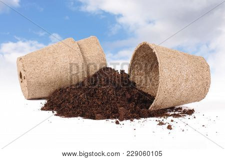 Concept Of Agriculture In Which You Can See Heap Of Soil And Peat Pots