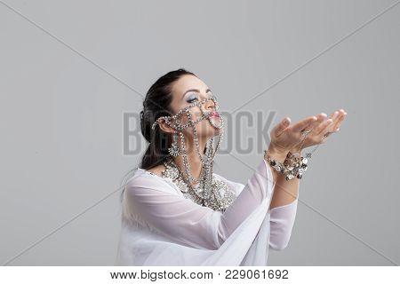 Sensual Arabic Fortune Teller On Gray Studio Background