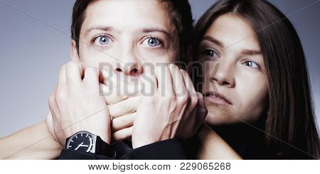 Gender Terror And Aggression: Woman Covers Man's Mouth. (fear, Gender Inequality, Violence, Dominati