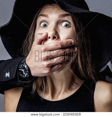 Domestic Terror And Aggression: Man Covers Woman's Mouth. (fear, Gender Inequality, Violence, Domina