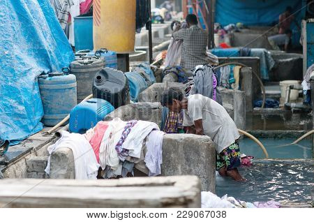 Mumbai, India - January 12, 2016: Indian Workers Washing Clothes At Dhobi Ghat, A Well Know Open Air
