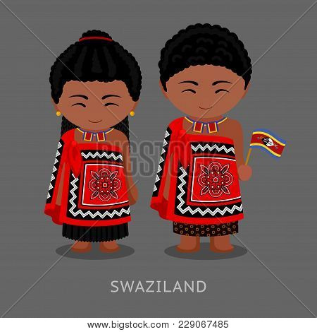 Swazi People In National Clothes With A Flag. Man And Woman In Traditional Costume. Travel To Swazil