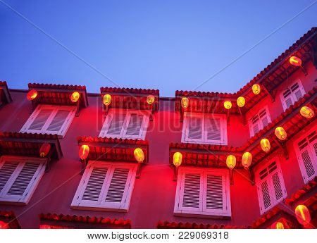 Red Building And Lantern During Blue Hour.