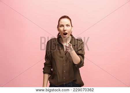 I choose you and order. The surprised business woman point you, want you, half length closeup portrait on pink studio background. The human emotions, facial expression concept. Front view. Trendy colors poster