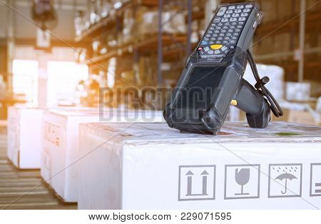 Barcode Scanner With Package Boxes In Warehouse Distribution, Data Transmission Device