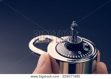 Security And Safety Concept, Miniature Figurine In Security Guard Uniform Standing On Combination Ci