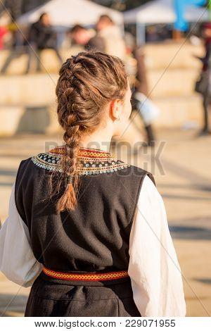 Pernik, Bulgaria - January 26, 2018: Female Dancer In Bulgarian Folklore Costume Shows Proudly Shows
