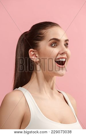 Beautiful Female Three-quarters Portrait. Isolated On Pink Studio Backgroud. The Young Emotional Hap