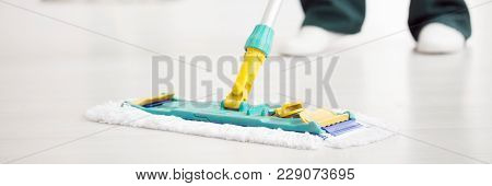 Cleaner Wiping Floor With Mop