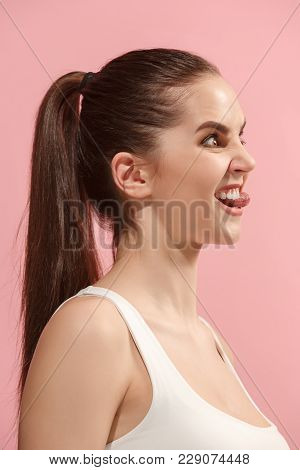 Beautiful Female Three-quarters Portrait. Isolated On Pink Studio Backgroud. The Young Emotional Cra