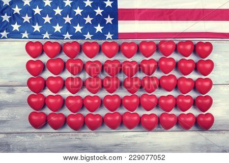 Fifty Red Hearts In A Row And American Flag