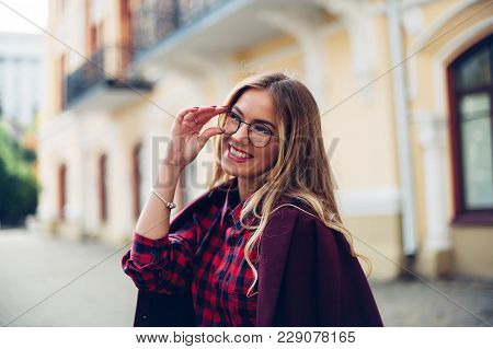 Cheerful Pretty Young Lady Holds His Glasses Her Hands And Smiles At His Interlocutor.