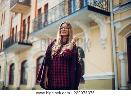 Outdoor Portrait Of A Young Beautiful Fashionable Happy Lady Posing On A Street City. Model Wearing