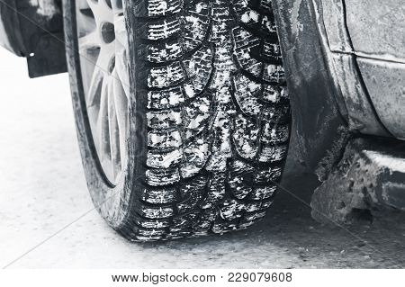 Close-up Photo Of Car Wheel On Snow Tire